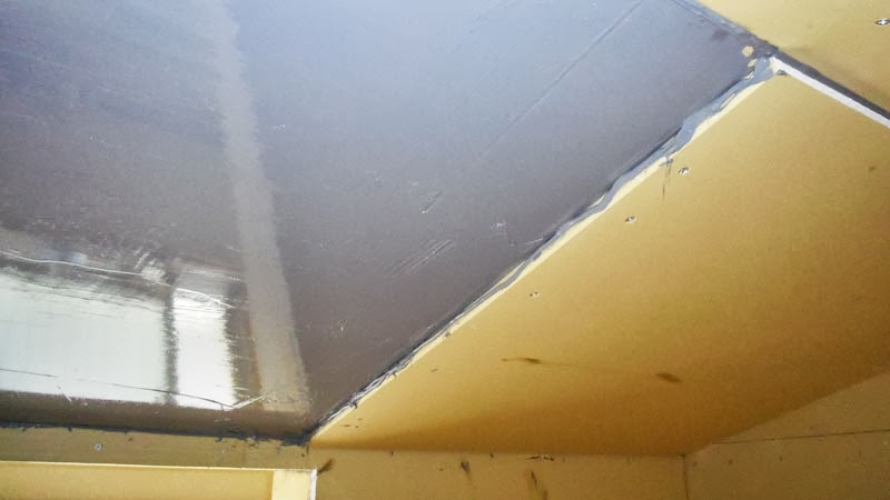 Silicone between layers of drywall